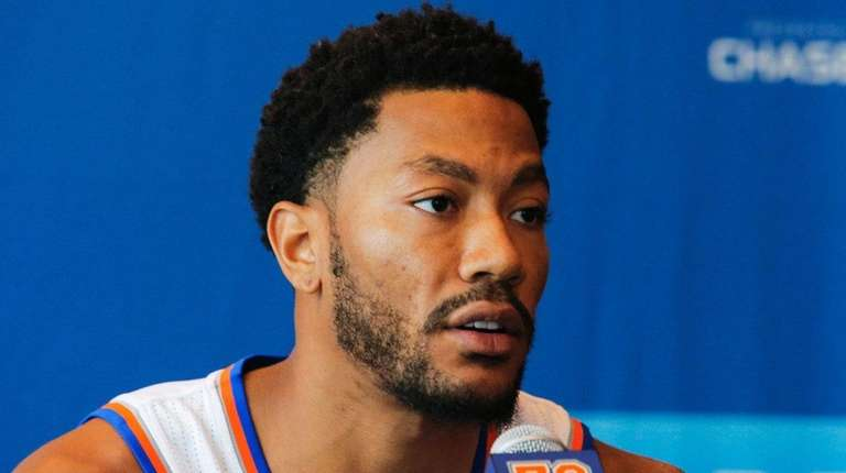 Derrick Rose speaks during a news conference at