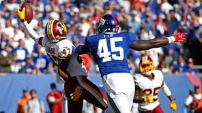Washington Redskins cornerback Quinton Dunbar (47) intercepts a