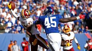 Washington Redskins cornerback Quinton Dunbar intercepts a pass