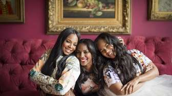 Tina Douglas, center, with daughters Ashanti, left, and