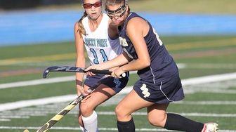Rocky Point's Haley Clark (11) and Bayport-Blue Point's