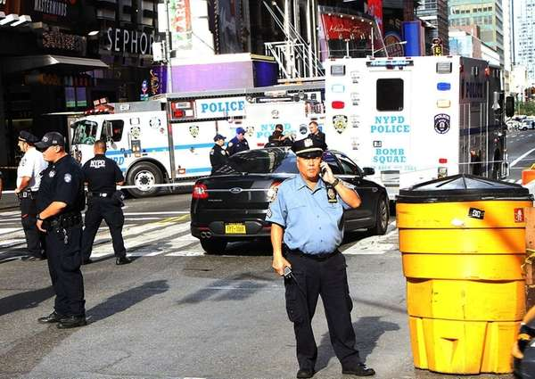 The NYPD's bomb squad check a suspicious package