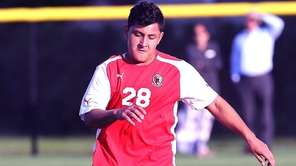 Mineola's Jose Erazo works the ball during a
