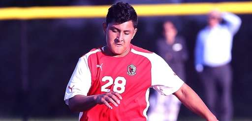 Mineola's Erick Marquez works the ball during a