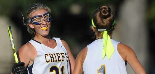Mackenzie Conkling of Massapequa, right, gets congratulated by