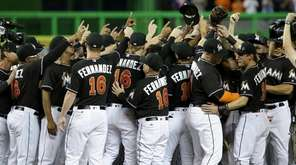 Miami Marlins players wearing a jersey in honor