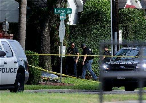 Police investigate the scene of a shooting that