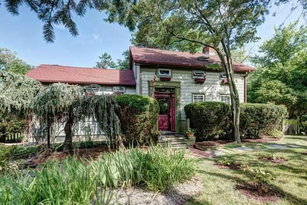 This four-bedroom Southold farmhouse was renovated in the
