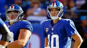 Eli Manning, right, threw two fourth-quarter interceptions that