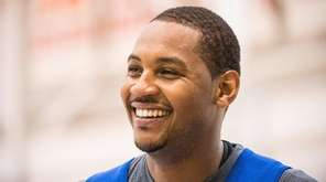 Knicks forward Carmelo Anthony smiles during practice at