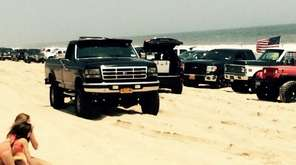 Trucks line the beach on the ocean east