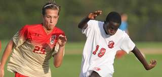 East Islip's Anoune Basse carries the ball while