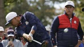 United States' Phil Mickelson watches as United States'