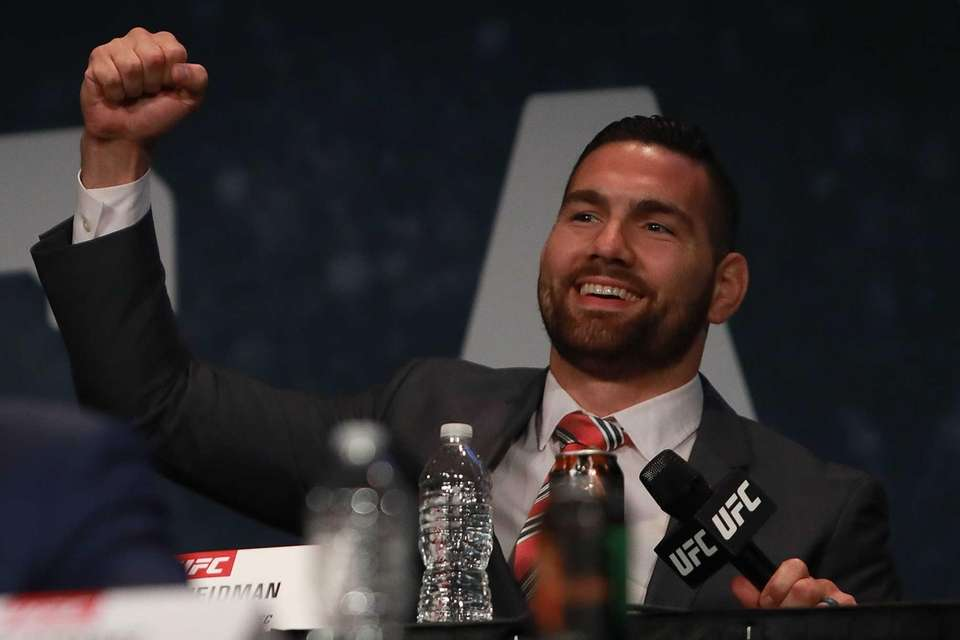 Chris Weidman reacts during the UFC 205 press