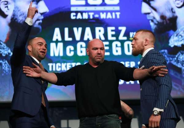 Conor McGregor and Eddie Alvarez face off as UFC president Dana White breaks them up at the UFC 205 press conference at The Theater at Madison Square Garden on Sept. 27, 2016.