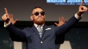Conor McGregor gestures to the crowd during the