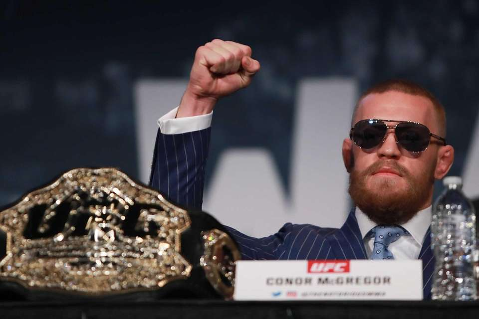 Conor McGregor reacts during the UFC 205 press