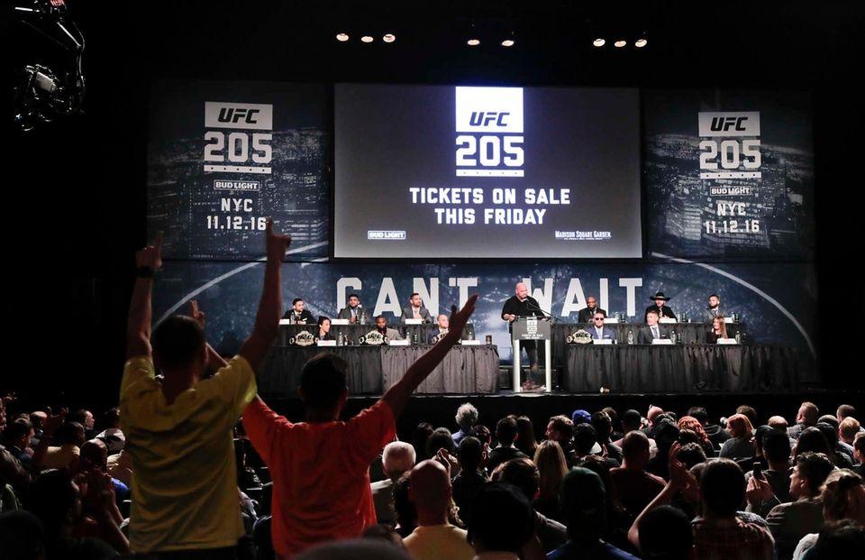 UFC president Dana White, center, speaks during a