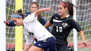 Shoreham-Wading River's Sophia Triandafilis controls the rebound of