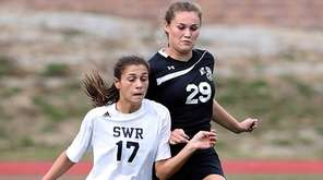 Shoreham-Wading River's Gianna Cacciola controls the pass in