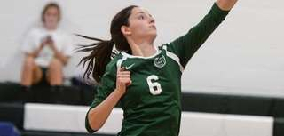 Holy Trinity's Maggie Lavelle hits the ball during