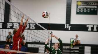 Holy Trinity's Jacqueline O'Neill hits the ball during