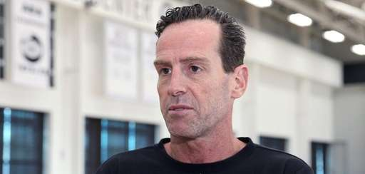 Nets head coach Kenny Atkinson talks to members