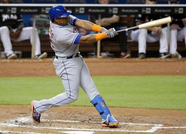 The Mets' Yoenis Cespedes hits a two-run home