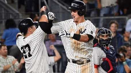 New York Yankees first baseman Tyler Austin celebrates
