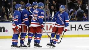 New York Rangers' Chris Kreider (20) celebrates with