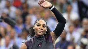 Serena Williams waves to fans after winning against