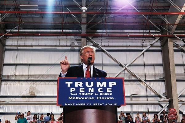 Donald Trump speaks at a Florida airport hanger