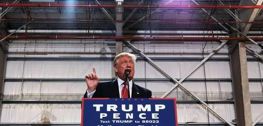 Donald Trump speaks at a Florida airport hanger