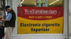 Signs advertising electronic cigarettes, vaporizers, and other tobacco