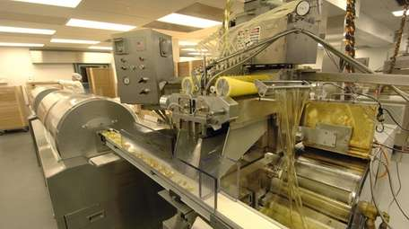 Supplements being manufactured at NBTY facility in Bohemia,