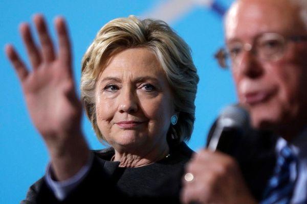 Democratic presidential candidate Hillary Clinton listens as Sen.