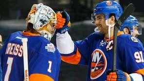 John Tavares and Thomas Greiss of the New