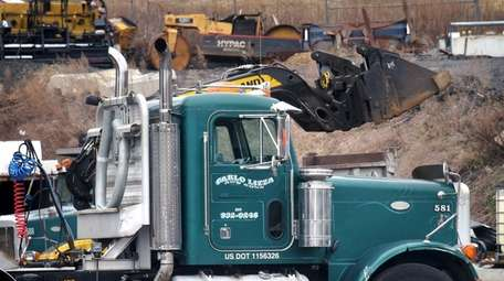 Construction vehicles and equipment are shown in the
