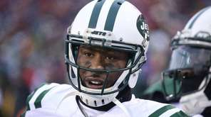 Jets wide receiver  Brandon Marshall looks on from