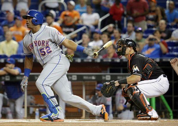 New York Mets' Yoenis Cespedes (52) follows through