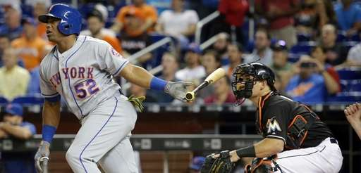 New York Mets' Yoenis Cespedes (52) follows through