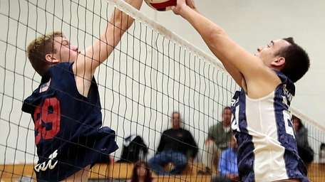 Eastport's Parker Bachisin, right, blocks the spike attempt
