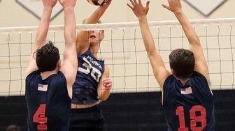 Eastport's Ryan Byrne, center, turns a dink away