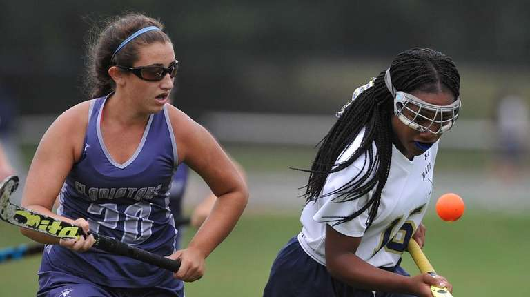 Nadia Elcock of Baldwin, right, gets pressured by