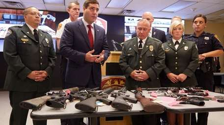 Suffolk County Police Commissioner Timothy Sini announcing an