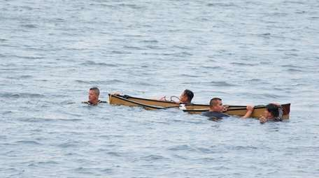 Suffolk police officers dove into the water to