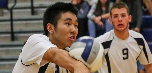 Daniel Kim of Plainview JFK, returns Massapequa's serve