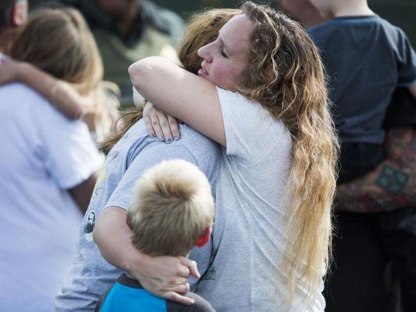 Korrie Bennett hugs Heather Bailey after recovering their