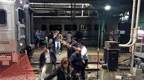 Passengers scramble to safety Thursday, Sept. 29, 2016,