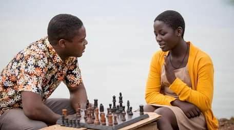 David Oyelowo, left, and Madina Nalwanga work to